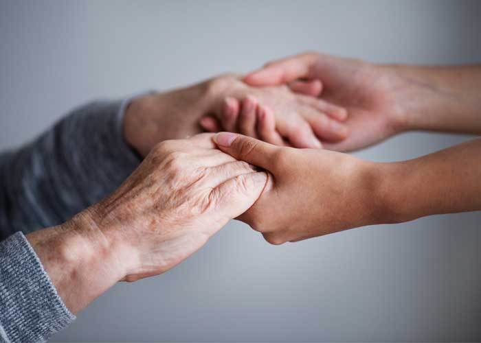 A caregiver offering a caring hand