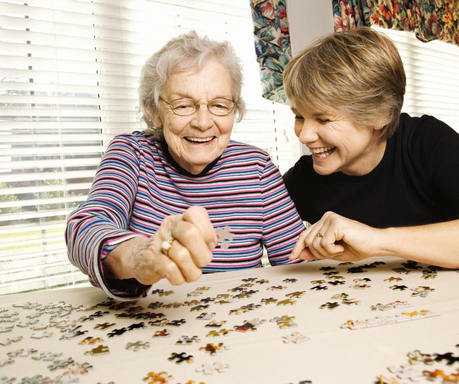 Senior Citizen Doing A Puzzle